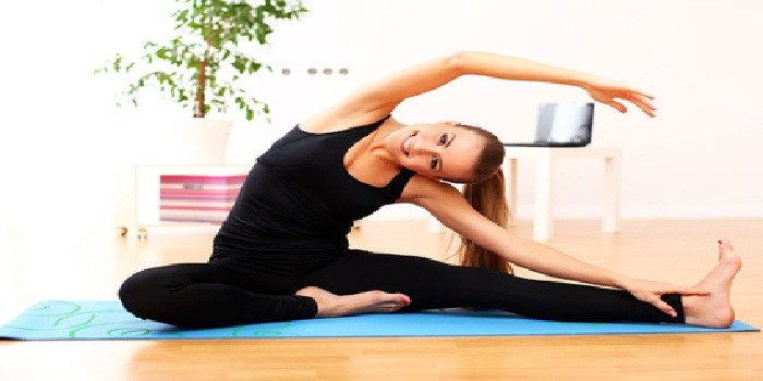 Happy and beautiful woman do yoga exercises at home